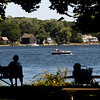 Amesbury: Boaters speed by as people relax in the shade at Alliance Park in Amesbury Sunday afternoon.Jim Vaiknoras/Staff photo