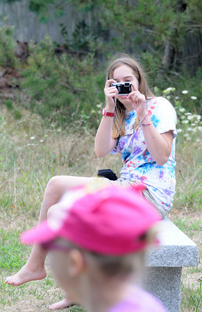 Newbury: Fiona Keene takes photos during the summer camp at the Mass Audubon's Joppa Flats Education Center Thursday morning. Jim Vaiknoras/Staff photo