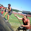 Amesbury: Runners in the Spartan Race at Amesbury Sports Park in Amesbury Struggle up the incline plane  Saturday. Jim Vaiknoras/Staff photo