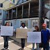 Salisbury:Displaced tenants Tina Whitney, Rhonda Devine, Linzie Colby, and Michael Toscano hold signs at teh corner of Ocean Blvd and Railraod Ave in Salisbury. The building, behind them, has been declared uninhabitable. Jim Vaiknoras/Staff photo