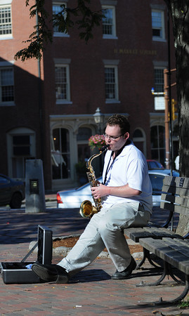 "Newburyport: Gordon Frances Blaney of Salisbury plays  tenor sax in Market Square in Newburyport Friday afternoon. Blaney, who is a graduate of Berkley School of music entertained with jazz standards like"" My Funny Valentine"" and ""Girl from Ipanema"". Jim Vaiknoras/Staff photo"