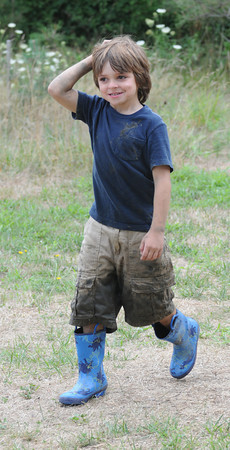Newbury: Dominic Twomblay, 6, got a bit of mud on him while learning about the salt marsh during summer camp at the Mass Audubon's Joppa Flats Education Center Thursday morning. Jim Vaiknoras/Staff photo