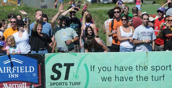 Amesbury: Runners in the Spartan Race at Amesbury Sports Park in Amesbury are greeted and cheer at the finish Saturday. Jim Vaiknoras/Staff photo
