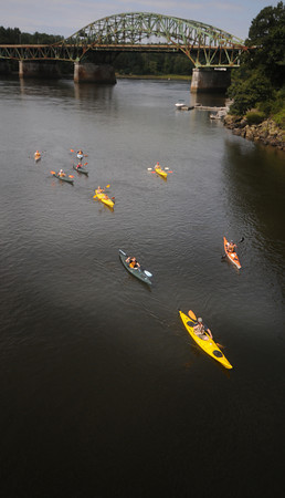 Amesbury: A group of kayakers make their way down the Merrimack River Sunday morning near the Whittier Bridge. Jim Vaiknoras/Staff photo