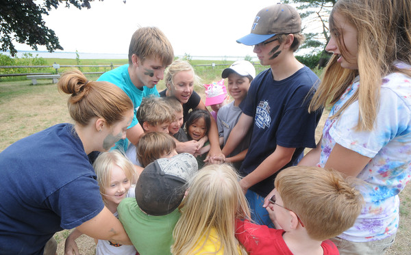Newbury: Interns and sudents at the summer camp at the Mass Audubon's Joppa Flats Education Center play Octopus Knot Thursday morning.The game involves a group ramdomly holding hands in a circle, then attempting to untangle without letting go. Jim Vaiknoras/Staff photo