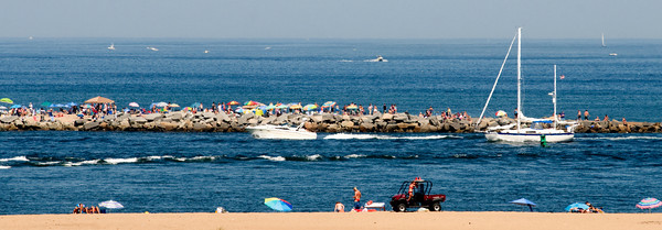 Salisbury: The view from the Plum Island lighthouse looking north across the Mouth of the Merrimack River to the boaters and beach goers on Salisbury Beach Sunday afternoon. Jim Vaiknoras/Staff photo