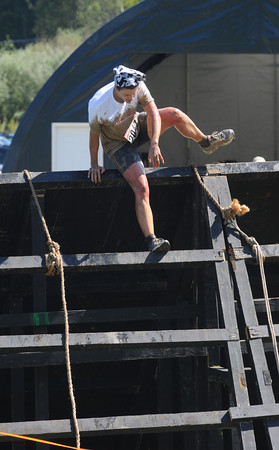 Amesbury: A runner clears an obsticle in the Spartan Race at Amesbury Sports Park in Amesbury Saturday. Jim Vaiknoras/Staff photo