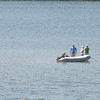 Merrimac: A group of boaters walk along a newly formed sand bar in the Merrimack River in Merrimac. Jim Vaiknoras/Staff photo