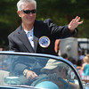 """Newburyport: Yankee Homecoming Chairman Don Walters waves to the crowd as the Yankee Homecoming Parade makes its way down High Street. """"I want to thank everyone for all their help this week,"""" he said. Jim Vaiknoras/Staff photo"""