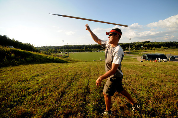 Amesbury: Brian Duncanson demostrates a spear throw at Amesbury Sports Park, the toss will be one of the obstacles in this weekends Spartan Race. JIm Vaiknoras/Staff photo