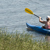 Newbury: A kayaker glides through the grass on Joppa Flatts Sunday morning. Jim Vaiknoras/Staff photo