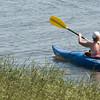 Newbury: A kayaker glides through the grass on Joppa Flatts Sunday morning. Jim Vaiknoras/Staff photo