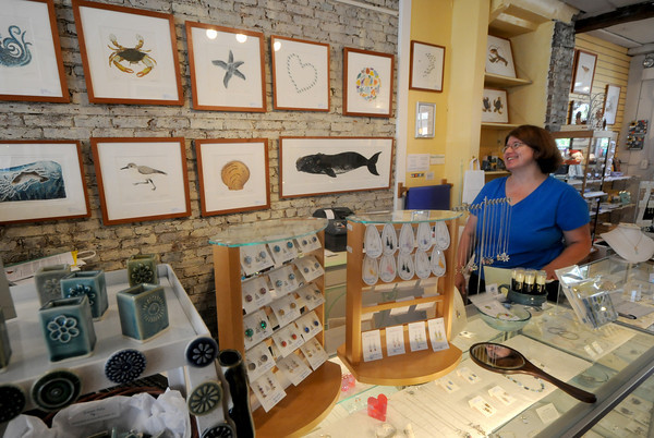 Newburyport: Diane Monroe of Valerie's Gallery on State Street in Newburyport. The store had a busy tax free weekend. Jim Vaiknoras/Staff photo
