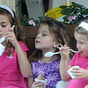 Newburyport: Annie Murphy, 7, and her sisters Lacey, 4, and Kylie 2, enjoy some ice cream at Simply Sweet on Inn Street in Newburyport Sunday afternoon. Jim Vaiknoras/Staff photo