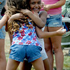 Seabrook: Sage Johnson hugs her freind Lauren Ruffin after winning the egg toss at Seabrook Old Home Days Saturday.. Jim Vaiknoras/Staff photo