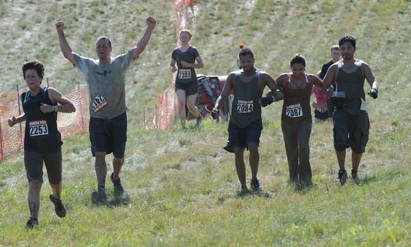 Amesbury: Runners in the Spartan Race at Amesbury Sports Park in Amesbury make it down the final hill Saturday. Jim Vaiknoras/Staff photo