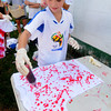 Amesbury: Madison McGrath makes a tie dye shirt with other members of Amesbury Youth Soccer Sunday at Woodsom Farm. The girls plan on waring the shirts when the travel up to Scarborough Maine for the Lobster Classic Soccer Tournament next weekend. Jim Vaiknoras/Staff photo