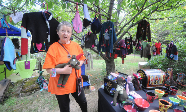 Salisbury:Artist Ingrid Regina displays her Sweetas, dolls made from recycled sweaters, along with her pottery and painted furniture at the eighth annual Atrsans in The Open Show on Ferry Road in Salisbury Sunday morning. Jim Vaiknoras