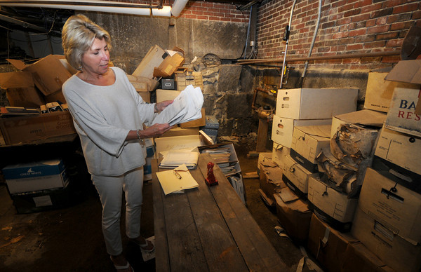 Newburyport: Newburyport Mayor's Executive Aide Lois Honegger looks through items found in the basement of Newburyport City Hall. JIm Vaiknoras/Staff photo