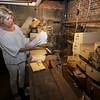 Newburyport: Newburyport Mayor's Executive Aide Lois Honegger looks through items found in the basement of Newburyport City Hall. JIm Vaiknoras/Staff photo
