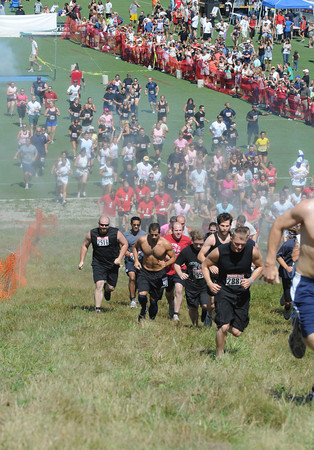 Amesbury: Runners in the Spartan Race at Amesbury Sports Park in Amesbury head off at the start Saturday. Jim Vaiknoras/Staff photo
