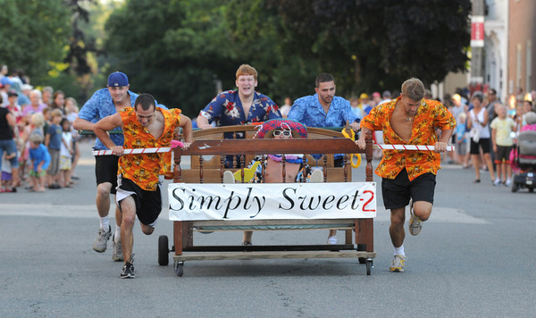 Newburyport: The Simply Sweet 2, winners of the Yankee Homecoming Bed Race sprint down Federal Street in Newburyport Thursday night. Jim Vaiknoras/Staff photo