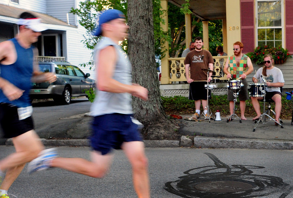 Newburyport: Members of That Toga Band had a drum line going for runners in the Yankee Homecoming 10 Mile race last night on Merrimac Street. Bryan Eaton/Staff Photo