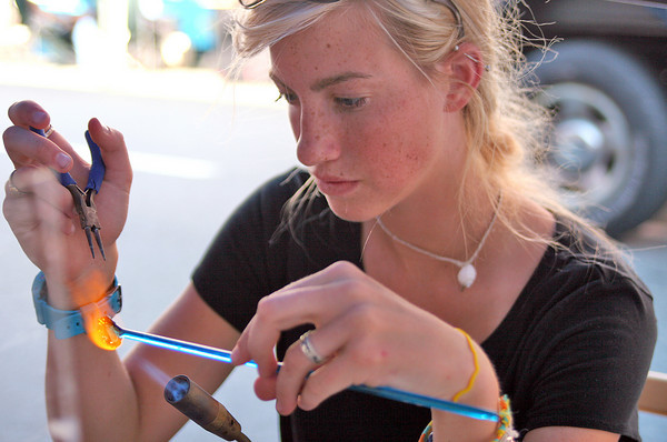 Newburyport: Kailey Burke, 17, of Haverhill, makes a glass bead at her booth, KBeads, during Tuesday's craft fair in downtown Newburyport. Photo by Ben Laing/Staff Photo