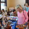 Newburyport: Nancy O'Laughlin of Maine browses some of the items available at the annual Yankee Homecoming antique show and sale at the Belleville Church Monday morning. Photo by Ben Laing/Staff Photo