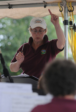 Newburyport: Director Karen Mundo conducts the Merrimack Valley Concert Band at Old-Fashioned Sunday in Newburyport. Jim Vaiknoras/Staff photo