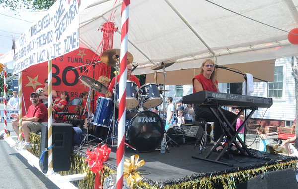 Newburyport: The Kathy's Tumbleweed Dance Studio float features a live rock band in the Yankee Homecoming Parade Sunday. Jim Vaiknoras/Staff photo