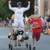 Newburyport: The entry from The Lions Club makes it's way down Federal Street in the Yankee Homecoming Bed Race  in Newburyport Thursday night. Jim Vaiknoras/Staff photo