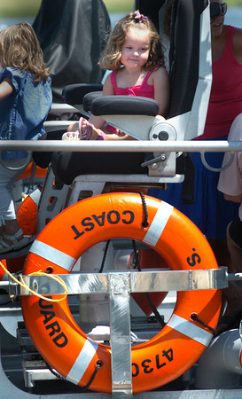 Newburyport: Grace Daigle, 3, of Newburyport sits on the pilot's chair on the bridge of a motor lifeboat at the U.S. Coast Guard Station Merrimack which hosted an open house yesterday. Bryan Eaton/Staff Photo