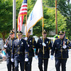 Newburyport: The Newburyport Police Color Guard heads down High Street in the Yankee Homecoming Parade Sunday. Jim Vaiknoras/Staff photo