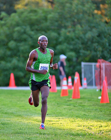 Newburyport: Derese Deniboda, 28, of Ethiopia, wins the men's 10 mile race at this year's Yankee Homecoming Road Race. Photo by Ben Laing/Staff Photo