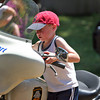 Newburyport: Luke Buckley, 4, of Amesbury, tests out a Newburyport Police motorcycle during Kids Day At The Park Wednesday morning at Atkinson Common. Photo by Ben Laing/Staff Photo