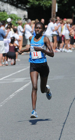 Newburyport: Winner of the women's 16 and over heat Salome Rosgei in the High Street Mile . Jim Vaiknoras/Staff photo