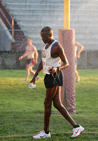 Newburyport: A runner cools down under the sprinklers after running the Yankee Homecoming 10 mile road race Tuesday night. Photo by Ben Laing/Staff Photo