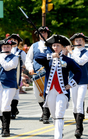 Newburyport: Nicole Hotchian leads the Windsor Fife and Drum Corps in the Yankee Homecoming Parade Sunday. Jim Vaiknoras/Staff photo