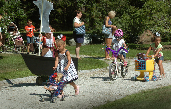 Newburyport: Participants of the Bike and Carriage Parade make the rounds at Atkinson Common for Kids Day in the Park. Bryan Eaton/Staff Photo