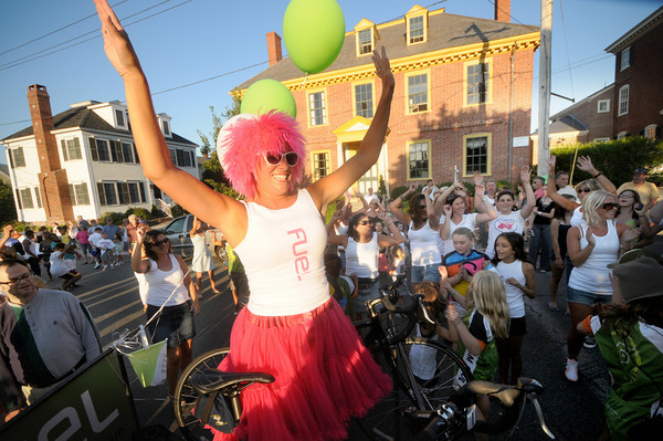 Newburyport: Amber Shelley rides the entry from Fuel as it dances it's  way down Federal Street in the Yankee Homecoming Bed Race in Newburyport Thursday night. Jim Vaiknoras/Staff photo