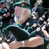 Newburyport: Dave Wathington of the Hibernians of Manchester, N.H., plays the pipes in the Yankee Homecoming Parade Sunday. Jim Vaiknoras/Staff photo