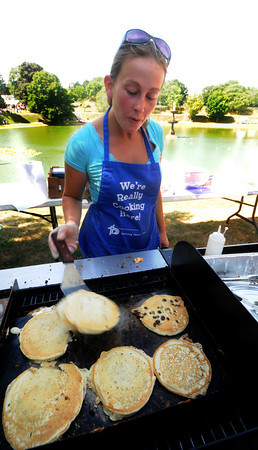 Newburyport: Diana Clark of Bradford flips pancakes at the Turning Point Pancake Breakfast at Old-Fashioned Sunday on the Bartlet Mall In Newburyport. Jim Vaiknoras/Staff photo