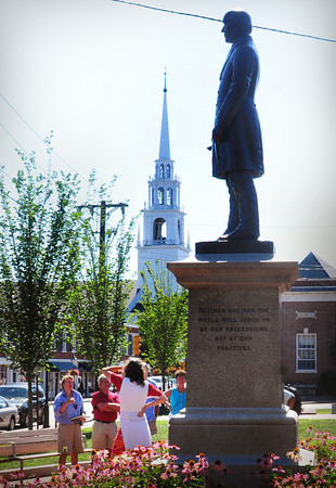 "Newburyport: Ghlee Woodworth, left, begins her tour ""African-Americans in 1800's Newburyport"" in front of the statue of abolitionist William Llyod Garrison before moving on the the Unitarian Church, in back. Bryan Eaton/Staff Photo"