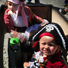 Newburyport: Sisters Justina Bucknill, 1, front and Julianna, 4, of Newbury had the pirate theme going for their entry to the carriage and bike parade at Kids Day in the Park. Bryan Eaton/Staff Photo