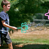 Newburyport: Karl Dorogy, 9, of Newburyport, makes some bubbles during Kids Day In The Park at Atkinson Common Wednesday morning. Photo by Ben Laing/Staff Photo