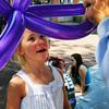 Newburyport: McKenna Hallinan, 6, of Georgetown gets a Mickey Mouse balloon made by artist Mr. Dee on Inn Street. Bryan Eaton/Staff Photo