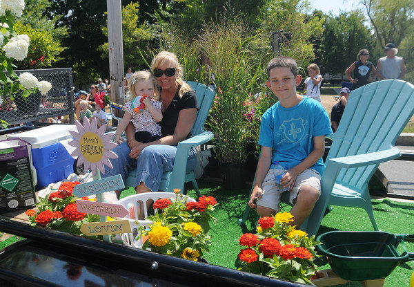 Newburyport: Mimmi Roy and her kids, Emme and Brock, ride in the Newburyport Mothers Club float in the Yankee Homecoming Parade Sunday. Jim Vaiknoras/Staff photo