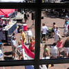 Newburyport: Market Square started filling up with people around lunchtime in a view from the second story of the Brass Lyon gift shop. Bryan Eaton/Staff Photo