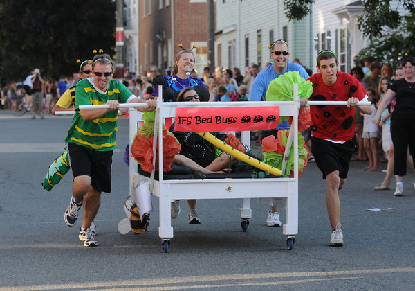 Newburyport: The Institution for Savings bed flies down Federal Street in the Yankee Homecoming Bed Race in Newburyport Thursday night. Jim Vaiknoras/Staff photo